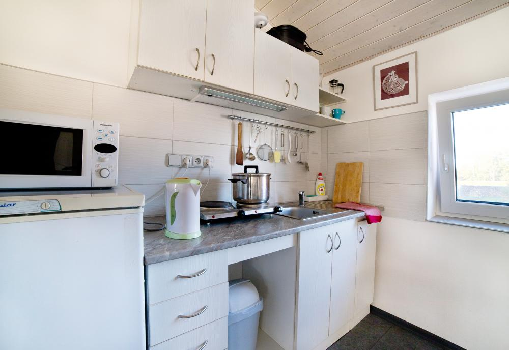 Kuchyňka s jídelnou jsou součástí obývacího prostoru.